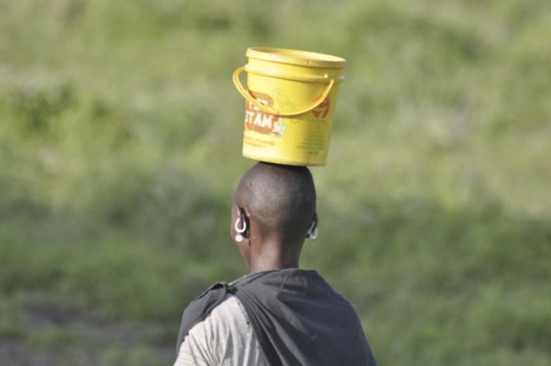 women carries water bucket