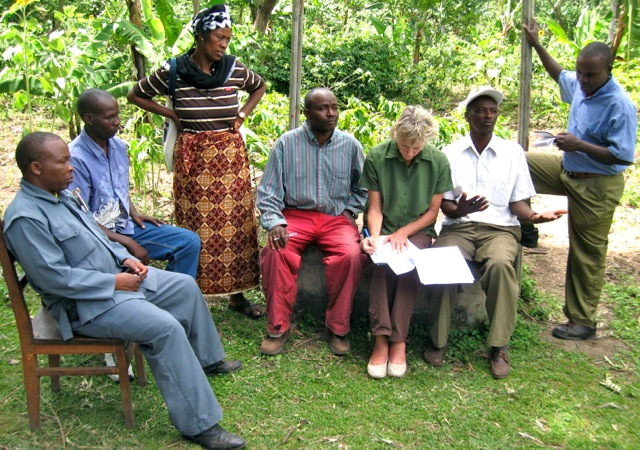 Leslie signing the contract with the villagers regarding well maintenance.